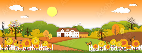 Paper art panorama Autumn landscape of grass fileds with farm house, tree on orang sky background, illustration cartoon of beautiful natural landscape of sunflowers field and butterfly in fall season.