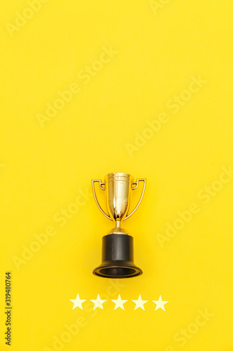 Simply flat lay design winner or champion gold trophy cup and 5 stars rating isolated on pink pastel background Fototapet