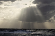 Cloudy Seascape With Light Rays