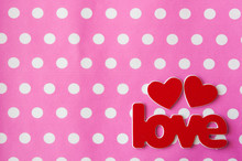 Word Love With Red Hearts On Pink Polka Dot Background. Greeting Card