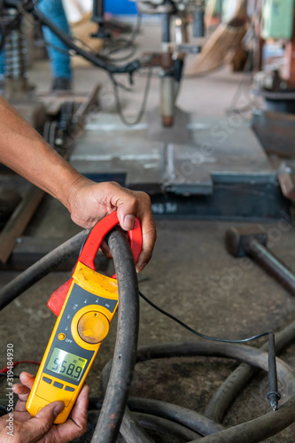 Measure amps while welding with digital clamp meter in process pre-qualification record(PQR) Canvas Print