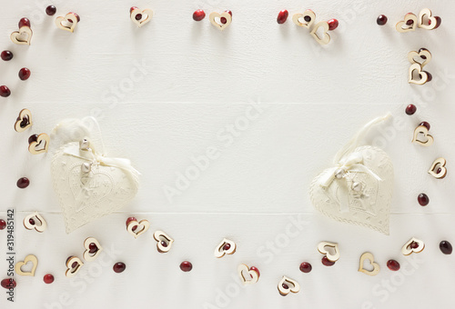 Romantic Valentine Christmas Frame - Empty White Wooden Background, Banner, Copy Space - with Two Vintage Hearts. Still Life Flat Lay Composition for Valentine Day, Christmas, Holiday. Winter Season.