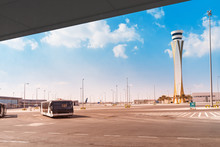 Airport Infrastructure - A Passenger Bus And A Control Tower