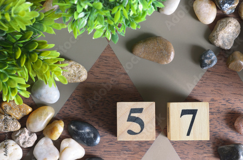 Fotografie, Obraz Number 57, Rating, Award, Design with number cube colorful stone in natural concept