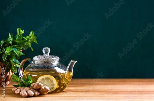 Fototapeta Fresh mint herbal tea in glass teapot, front view background obraz
