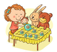 Girl Is Playing With Her Toys Making Tea Party At The Table With Small Cups And A Teapot
