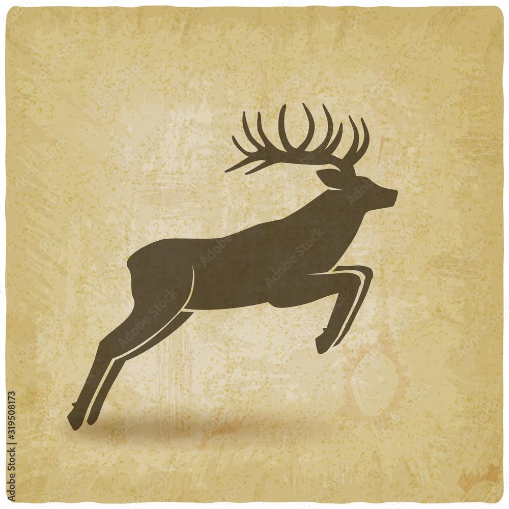 Fototapeta Jumping horned deer on vintage background