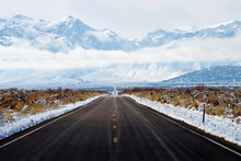 A Road, Route 167, Disappears Into The Horizon In The Winter Headed Towards The Sierra Nevada Mountains Near Lee Vining, California.