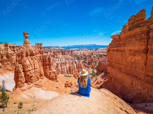 Canvas Print Young woman travels Bryce Canyon national park in Utah, United States, people travel explore nature