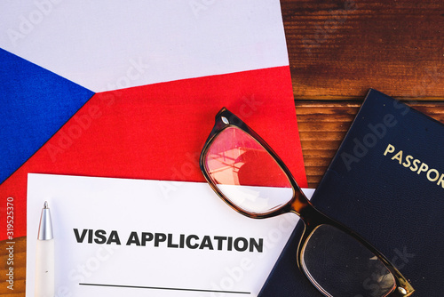 Flag of Czech Republic , visa application form and passport on table Canvas Print