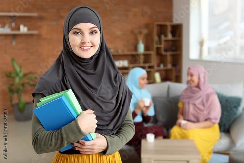 Female Muslim student at home Wallpaper Mural