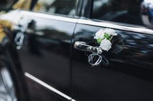 Decoration Of The Wedding Black Car Close Up. White Roses, Door And Handle.