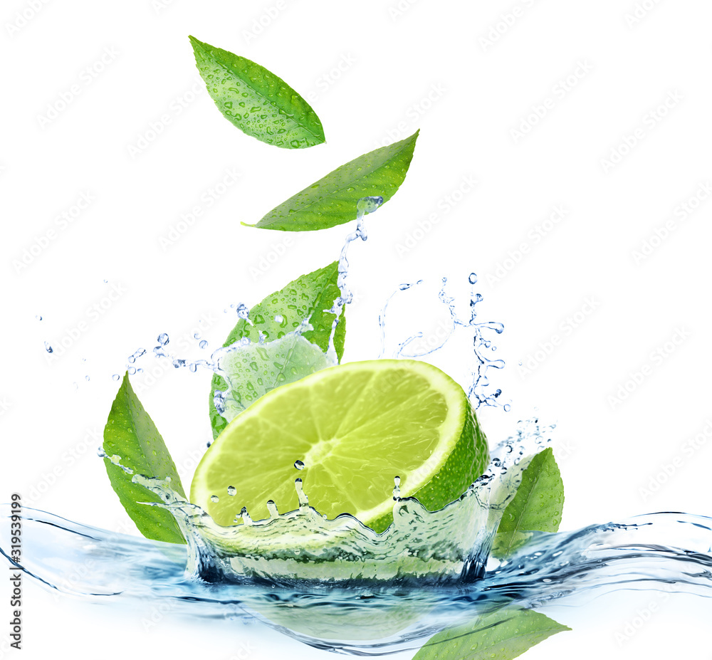 Fototapeta Ripe lime, fresh mint and splashing water on white background