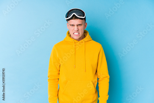 Young skier man screaming very angry and aggressive. Canvas-taulu