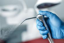 Female Hand Of Dentist In Blue...