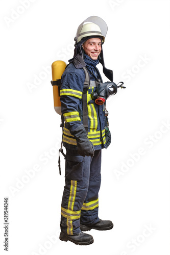 Young fireman with a mask and an air breathing apparatus on his back in a fully Canvas Print
