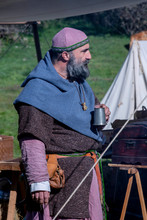 Viking Man In A Camp, Drinking From A Metal Jug