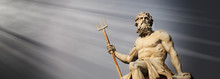 The Mighty God Of Sea And Oceans Neptune (Poseidon) Against Blue Sky Background. The Ancient Statue.