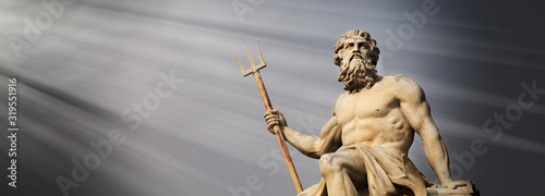 Obraz na plátně The mighty god of sea and oceans Neptune (Poseidon) against blue sky background
