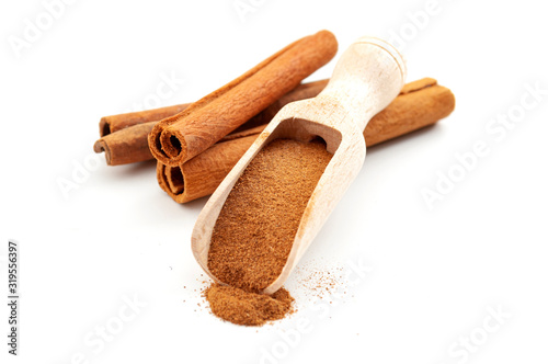Taste enhancing and flavour spice concept with wooden scoop with fine powder and Wallpaper Mural