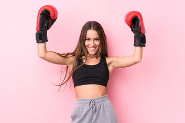 Young caucasian sporty woman boxing