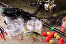 Fishing Tackle On A Wooden Tab...