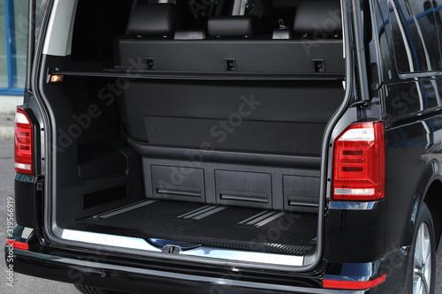 Fototapeta Modern car with open empty trunk outdoors