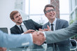 handshake of business people on a blurred office background.