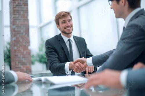 Fototapeta business partners greet each other at a business meeting. obraz na płótnie