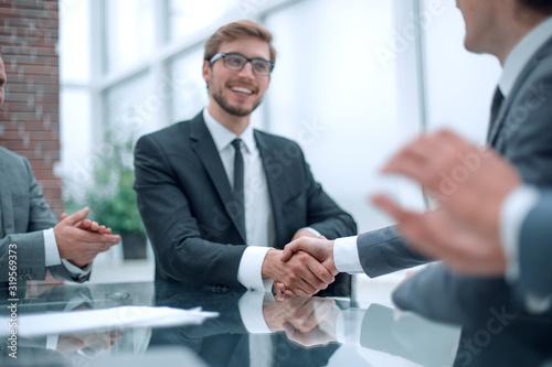 Fototapeta smiling businessman shaking hands with his business partner obraz na płótnie