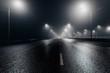 Leinwandbild Motiv Foggy misty night road illuminated by street lights