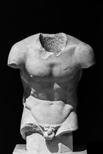Classical Roman Sculpture In Ruins Without Head And Arms Showing Athletic Male Torso - Black And White Photo