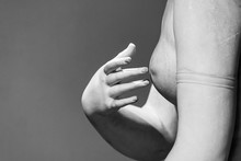 Detail Of Classical Roman Sculpture Showing Female Naked Statue Touching A Finger On Her Breast Nipple - Black And White Photo
