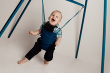 Jolly Baby Boy Bouncing In Jumper  / Jumping Stand.