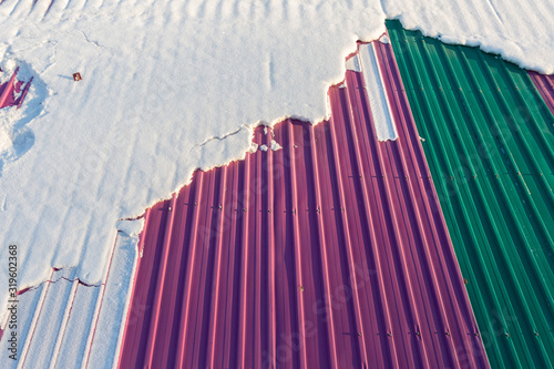 Snow on the colorful zinc roof Wallpaper Mural