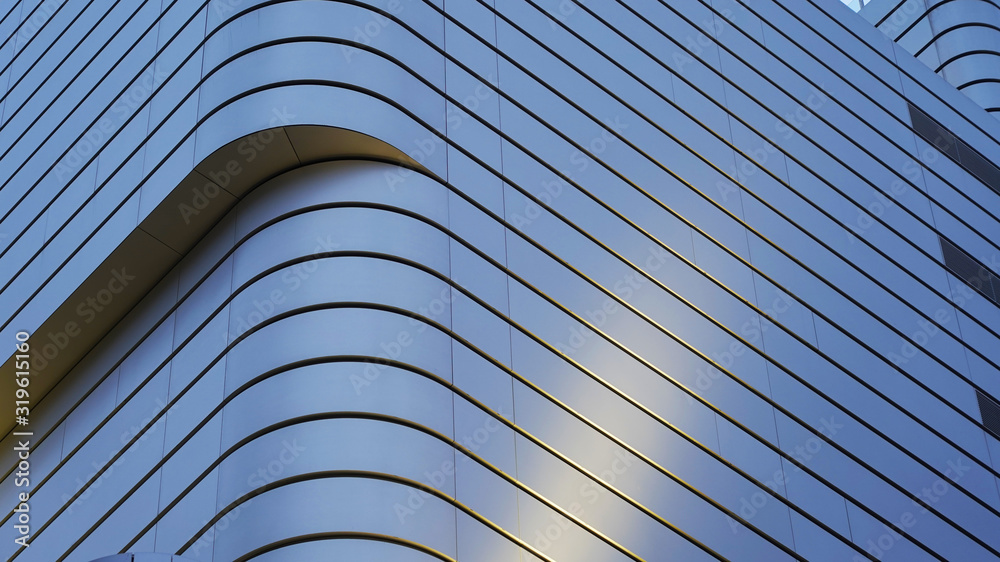 Fototapeta Textures from the facades of night buildings. geometric texture. modern architecture, illumination. composition of curved shapes