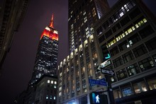Low Angle View Of Illuminated Empire State Building In City At Dusk