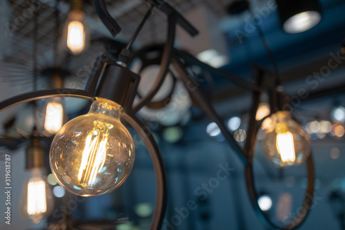 Close-Up Of Illuminated Light Bulb - fototapety na wymiar