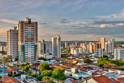 Obraz HIGH ANGLE VIEW OF BUILDINGS IN CITY AGAINST SKY - fototapety do salonu