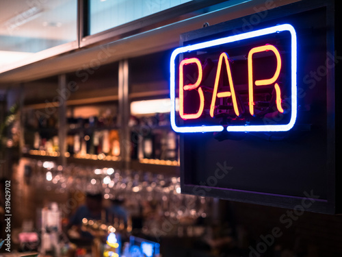 Obraz Bar Neon sign with Blur counter bar background - fototapety do salonu