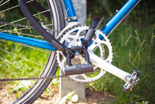 Close-Up Of Locked Bicycle Wheel