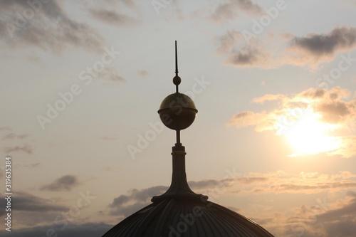 Fototapeta Spire Against Sky During Sunset obraz