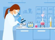 Woman Scientist Looking Micros...