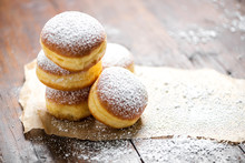 Close-up Of Donuts (Berlin Pancakes) Dusted With Powdered Sugar Served On A Rustic Wooden Table