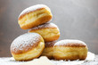 canvas print picture - Close-up of donuts (Berlin pancakes) dusted with powdered sugar served on a rustic wooden table