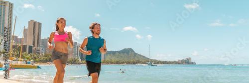 Leinwand Poster Runners couple running jogging on Hawaii Waikiki beach exercising outdoor in Honolulu city