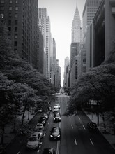 City Street By Chrysler Building Against Clear Sky