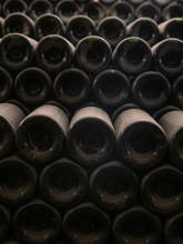 Dusty Old Wine Bottles Stacked...