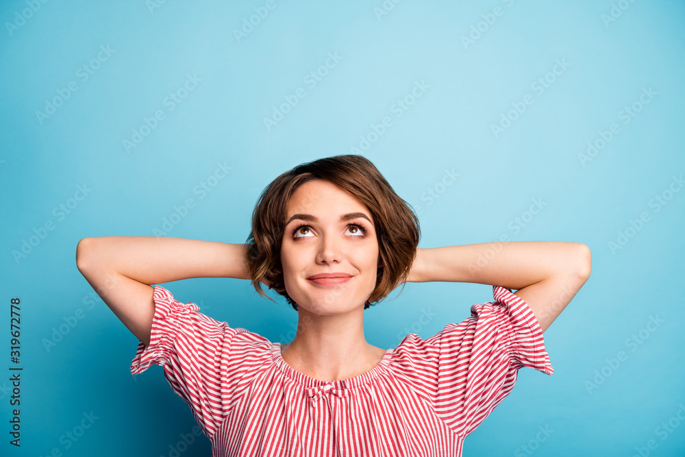 Fototapeta Closeup photo of attractive funny lady hold hands behind head look up empty space dreamer enjoy vacation time wear casual white red blouse isolated blue color background