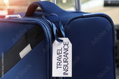 Blue suitcase with Travel Insurance label Canvas Print